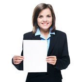 Attractive young woman in a black jacket. Holds a poster. — Stock Photo