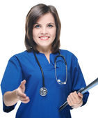 Attractive young nurse in uniform. Holds a folder and gives a ha — Stock Photo