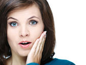Surprised young woman in a blue shirt. — Stock Photo