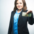 Stock Photo: Happy young woman in a black jacket. Holding dollars.