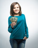 Attractive young woman in a blue shirt. Holding money.  — Stock Photo