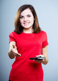 Smiling young woman in a red shirt. Keep a notepad and pen and g — Stock Photo