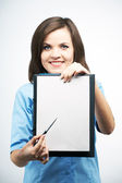 Smiling young woman in a blue blouse. Holds a poster and points  — Stock Photo
