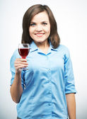 Smiling young woman in a blue shirt. Holding a glass of wine. — Stock Photo
