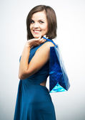 Attractive young woman in a blue dress. Holds a gift bag. — Foto de Stock