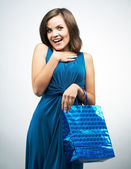 Attractive young woman in a blue dress. Holds a gift bag.  — Stock fotografie