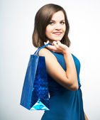 Attractive young woman in a blue dress. Holds a gift bag.  — Stock Photo