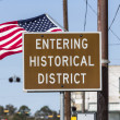 Entering Historical District Road Sign with American Flag — Stock Photo