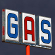 Stock Photo: Old Decayed Gas Sign with Thunderstorm Sky