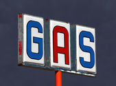 Old Decayed Gas Sign with Thunderstorm Sky — Stock Photo