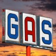 Stock Photo: Old Decayed Gas Sign with Sunset Sky