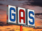 Old Decayed Gas Sign with Sunset Sky — Stock Photo