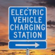 Electric Vehicle Charging Station Sign with Sunset Sky — Stock Photo #32664753