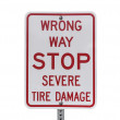 Stock Photo: Wrong Way Stop Severe Tire Damage Sign