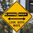 Stock Photo: Look Both Ways Bus and Tram Warning Sign