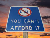 DUI You Can't afford it Warning Sign with Sunset Sky  — Stock Photo