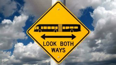 Look Both Ways Bus Warning Sign Time Lapse — Stock Video