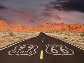 Route 66 Pavement Sign with Red Rock Mountain Sunset — Stock Photo
