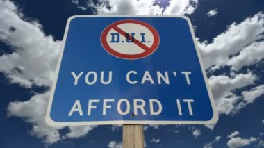 DUI You Can't Afford It Warning Sign with Time Lapse Clouds — Stock Video