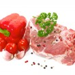 Raw meat with vegetables and spices on a white background — Stock Photo