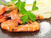 Prawns with a sprig of parsley and salad — Stock Photo