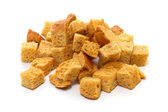 White bread croutons on a white background — Foto de Stock