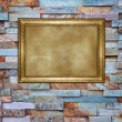 Picture frame on a brick wall — Stock Photo