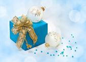 Christmas balls and gift — Stock Photo