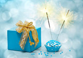 Birthday cake with sparkler and gift — Stock Photo