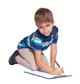 Boy writes in his diary. Isolated over white background. — Stock Photo