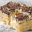 Cake from flaky pastry with whipped cream — Stok fotoğraf