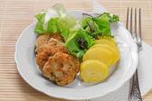 Hamburgers with mint and potatoes — Stock Photo