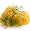 Royalty-Free Stock Photo: Vermicelli pasta nests with rosemary on a white background