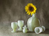 Still Life with Sunflowers, jug and glasses — Photo