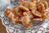 Mini pancakes on a plate — Stock Photo