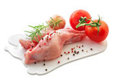 Raw rabbit meat with vegetables — Stock Photo