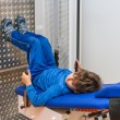 Child is therapeutic exercises in the gym — ストック写真