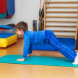 Child is therapeutic exercises in gym — Stock Photo #21813139
