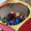 Stock Video: Kid playing with colored balls