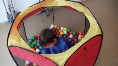Kid playing with colored balls — Stock Video