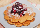 Wafers with berries and powdered sugar — Stock Photo
