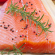 Fresh salmon fillet with herbs and vegetables — Stock Photo