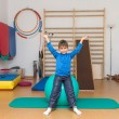 Child is therapeutic exercises in gym — Stock Photo #24106127