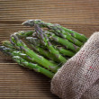 Fresh asparagus on a wooden background — Stock Photo