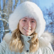Girl in a fur hat — Stock Photo #28119305