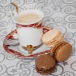 French macarons with a cup of coffee — Stock Photo