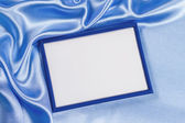 Delicate silk background with frame for photo — Stock Photo