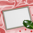 Christmas background with frame for photo and holly leaves — Stock Photo