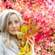 Portrait of a girl with autumn leaves — Stock Photo
