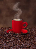 Coffee in a red cup — Stock Photo